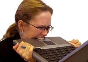 woman biting computer